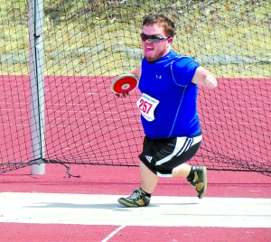 Photo courtesy of Tim Murray: Tim Murray displays excellent form for his bronze medal winning throw in discuss at DAAA National Games in San Diego